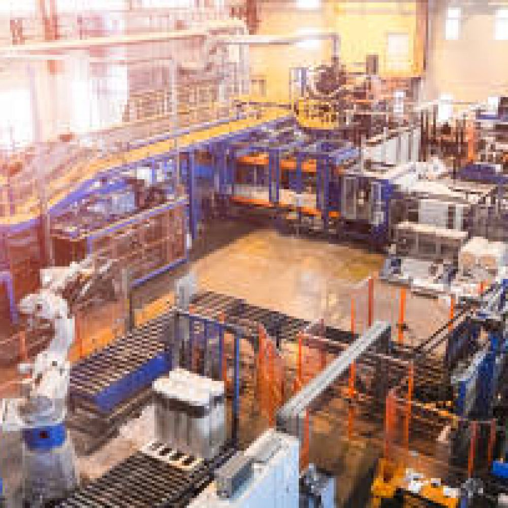 Factory workshop interior and machines on glass production background